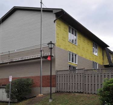 Re-siding of 112 houses, 3205 Uplands, Ottawa